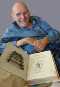 Image of Reginaldus Foster with one of his books